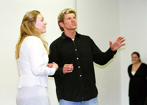 Rachel Payne (Trudy) looks on as Brent Schindele (Cain) sings See the Light